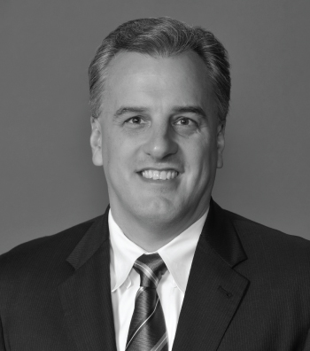 black and white professional headshot of a man
