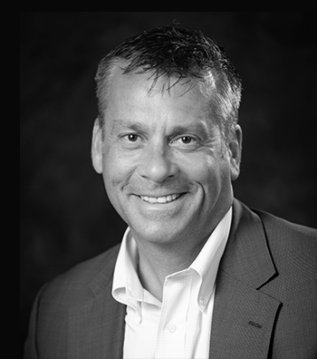 black and white professional headshot of a man on the leadership team